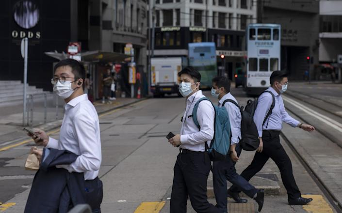 Hong Kong is caught between its desire to reopen and the government's zero tolerance for any cases of Covid-19 - Bloomberg