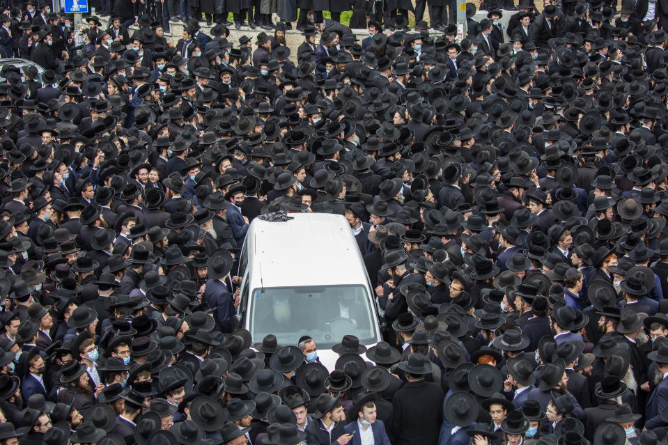 Thousands of ultra-Orthodox Jews participate in the funeral for prominent Rabbi Meshulam Soloveitchik, in Jerusalem, Sunday, Jan. 31, 2021. The mass ceremony took place despite the country's health regulations banning large public gatherings, during a nationwide lockdown to curb the spread of the coronavirus. (AP Photo/Ariel Schalit)