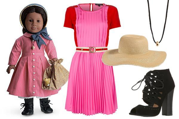 """<div class=""""caption-credit""""> Photo by: Courtesy of American Girl</div><b>Addy Walker</b> (1864) - Like all of the American Girls, Addy's outfit represents an important time in history - not just of this country, but of its people. Her cinnamon, cinched-waist dress was given to her as a gift and is symbolic of her transition into a society where she is free to create an identity for herself, while her great grandmother's shell necklace is a reminder of her heritage and her past. <br> <br>"""