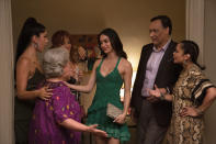 """This image released by Warner Bros. Pictures shows, from left, Stephanie Beatriz, from left, Olga Merediz, Dascha Polanco, background obscured, Melissa Barrera, Jimmy Smits and Daphne Rubin-Vega in a scene from """"In the Heights."""" (Macall Polay/Warner Bros. Pictures via AP)"""