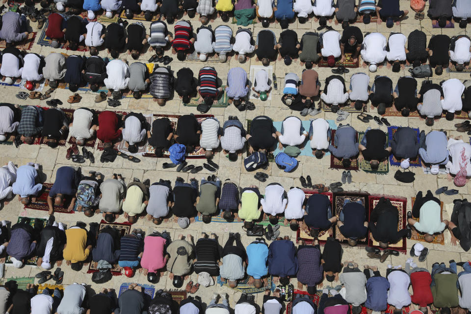 Worshippers take part in the last Friday prayers of the Muslim holy month of Ramadan at the Dome of the Rock Mosque in the Al Aqsa Mosque compound in the Old City of Jerusalem, Jerusalem, Friday, May 7, 2021. (AP Photo/Mahmoud Illean)