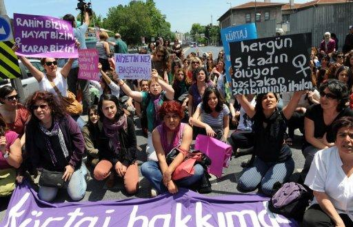 <p>Turkish feminists protest outside Prime Minister Recep Tayyip Erdogan's office in Istanbul on May 27. Some 300 women are to protest to the Turkish government Tuesday after Prime Minister Recep Tayyip Erdogan sparked fury among women's rights advocates by likening abortion to murder.</p>