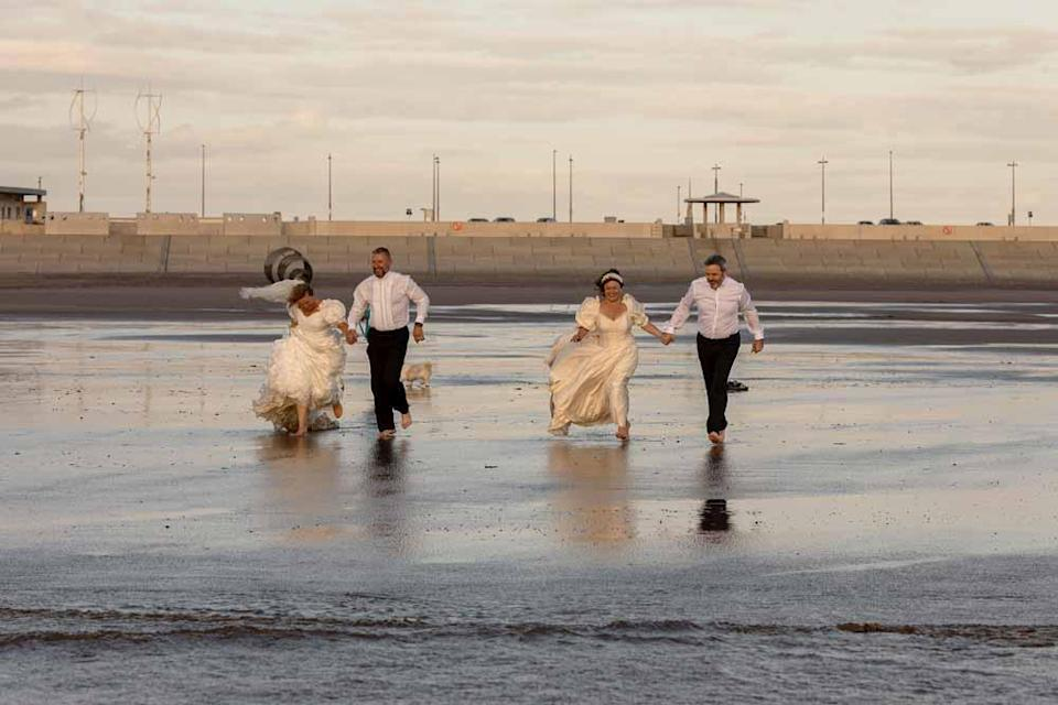 The two couples running in the sea (PA Real Life/Ashley Barnard).