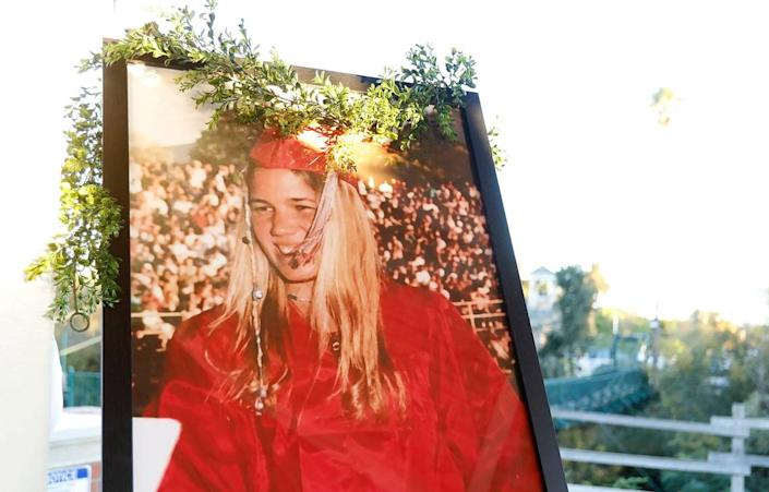 A large portrait of Kristin Smart in high school graduation attire is on display at a candlelight vigil for the missing woman in Arroyo Grande in January 2020.