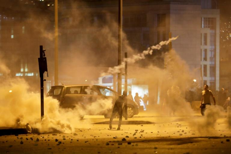 Dozens of Lebanese were injured on Saturday in the most violent night of clashes since anti-government protests began in October