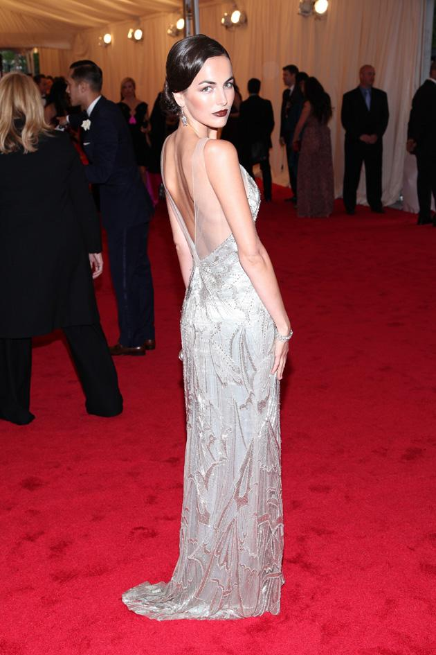 Camilla Belle was on trend in a metallic backless Ralph Lauren dress / WENN