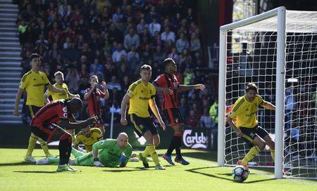 Bournemouth's Benik Afobe looks dejected as Middlesbrough's Brad Guzan watches the ball go past
