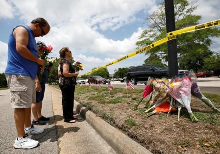 Vic Wirhowski, a local municipal worker, bows his head as he pays his respects at a makeshift memorial outside a municipal government building where a shooting incident occurred in Virginia Beach, Virginia