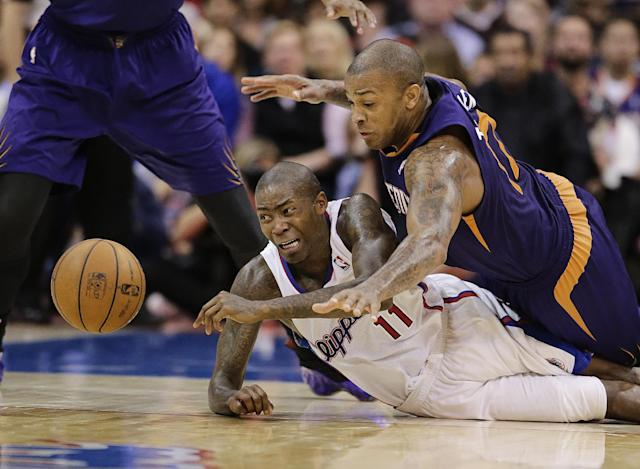 Los Angeles Clippers' Jamal Crawford (11) and Phoenix Suns' P.J. Tucker (17) go after the loose ball during the second half of an NBA basketball game on Monday, Dec. 30, 2013, in Los Angeles. (AP Photo/Jae C. Hong)