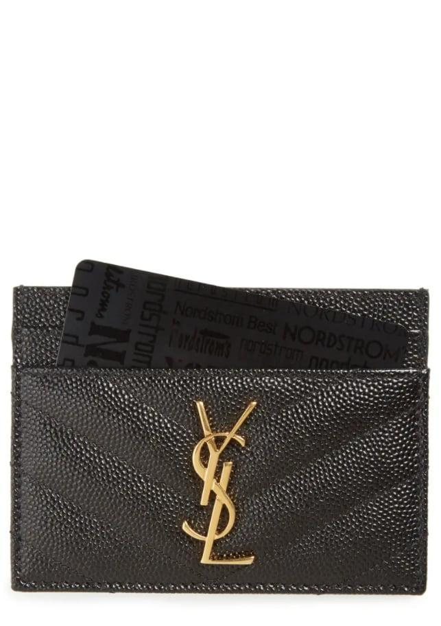 <p>They'll get plenty of use out of this <span>Saint Laurent Monogram Quilted Leather Credit Card Case</span> ($275).</p>