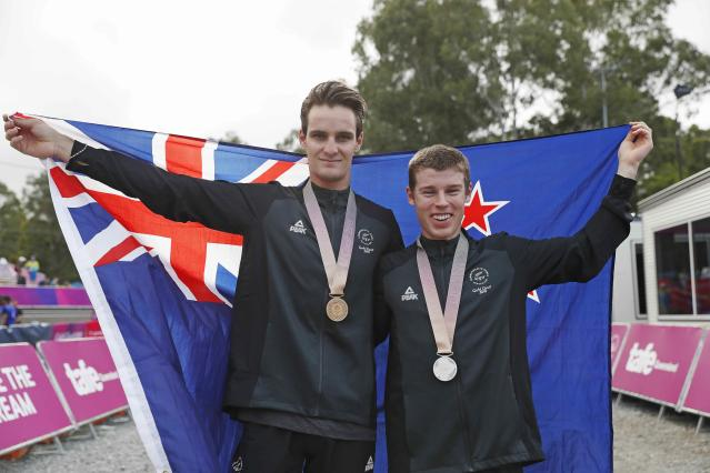 Cycling Cross-Country - Gold Coast 2018 Commonwealth Games - Mountain Bike - Men's Cross-Country - Nerang Mountain Bike Trails - Gold Coast, Australia - April 12, 2018. Gold medallist Samuel Gaze of New Zealand and silver medallist Anton Cooper of New Zealand pose with their medals. REUTERS/Paul Childs