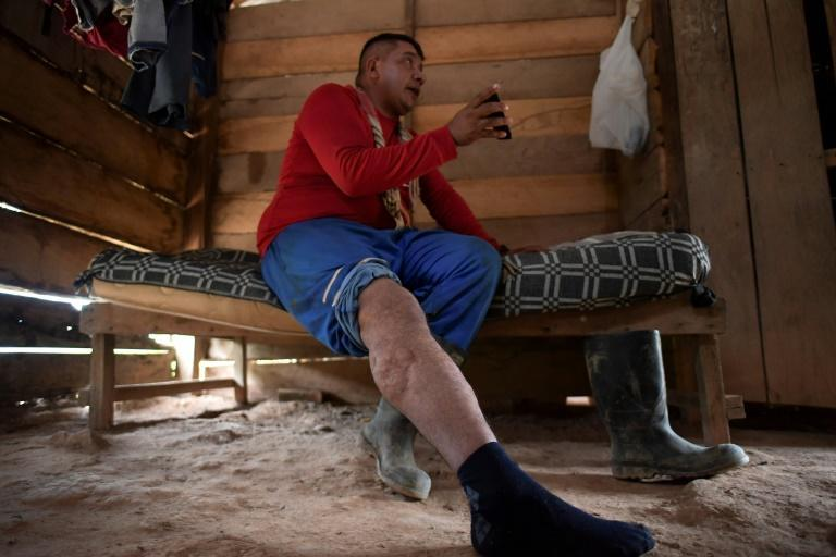 Efrain Soto shows a picture of his late brother Carlos, who died after stepping on a landmine