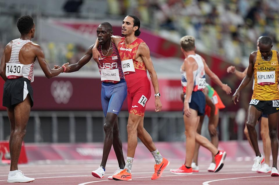 Mohamed Katir R of Spain and Paul Chelimo of the United States react during the men's 5000m heats at Tokyo 2020 Olympic Games, in Tokyo, Japan, Aug. 3, 2021. (Photo by Lui Siu Wai/Xinhua via Getty Images)