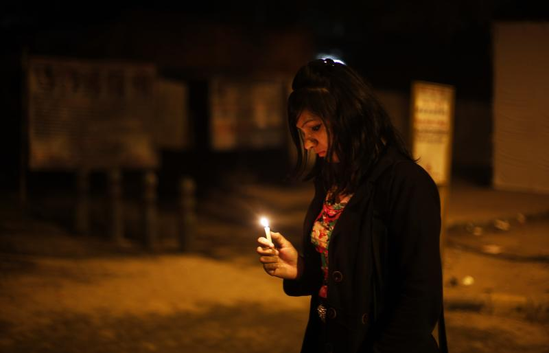 A young Indian woman holds a candle as she joins others in commemorating last year's gang rape and murder of a young woman in New Delhi, India, Sunday, Dec. 15, 2013. Public anger against crimes against women exploded after a fatal gang-rape of a young woman on a New Delhi bus on Dec.16, 2012. In some ways, the case cracked a cultural taboo surrounding discussion of sexual violence in a country where rape is often viewed as a woman's personal shame to bear. (AP Photo/Altaf Qadri)