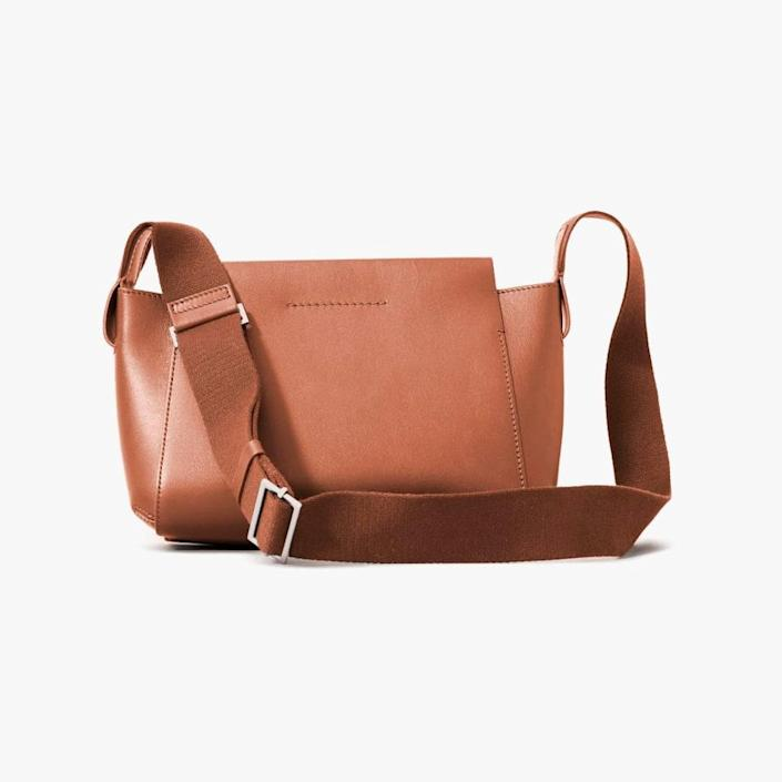 """$190, EVERLANE. <a href=""""https://www.everlane.com/products/womens-form-crossbody-bag-bone?collection=womens-backpacks-bags"""" rel=""""nofollow noopener"""" target=""""_blank"""" data-ylk=""""slk:Get it now!"""" class=""""link rapid-noclick-resp"""">Get it now!</a>"""