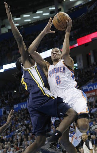 Oklahoma City Thunder guard Thabo Sefolosha (2) is fouled by Utah Jazz forward DeMarre Carroll (3) during the first quarter of an NBA basketball game in Oklahoma City, Friday, Nov. 30, 2012. (AP Photo/Sue Ogrocki)