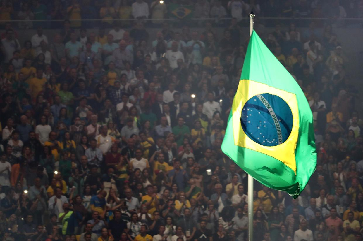 RIO DE JANEIRO, BRAZIL – AUGUST 05: The Brazil flag is raised during a performance at the Opening Ceremony of the Rio 2016 Olympic Games at Maracana Stadium on August 5, 2016 in Rio de Janeiro, Brazil. (Photo by Buda Mendes/Getty Images)