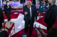 President Donald Trump talks with voters after an NBC News Town Hall, at Perez Art Museum Miami, Thursday, Oct. 15, 2020, in Miami. (AP Photo/Evan Vucci)