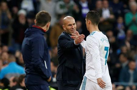 FILE PHOTO: Soccer Football - La Liga Santander - Real Madrid vs Sevilla - Santiago Bernabeu, Madrid, Spain - December 9, 2017 Real Madrid coach Zinedine Zidane shakes hands with Cristiano Ronaldo as he is substituted off REUTERS/Javier Barbancho