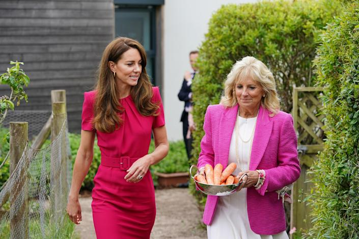 Catherine, Duchess of Cambridge and first lady Jill Biden, carry carrots for the school rabbits during a visit to Connor Downs Academy, during the G7 summit in Cornwall on June 11, 2021, in Hayle, Cornwall, England. / Credit: Aaron Chown / Getty Images