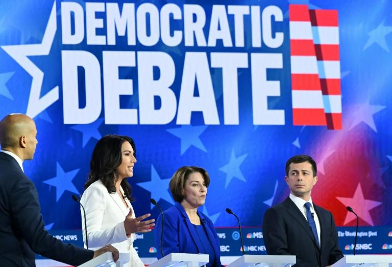 Democratic presidential hopefuls (L-R) Senator Cory Booker, US Representative Tulsi Gabbard, Senator Amy Klobuchar and South Bend, Indiana Mayor Pete Buttigieg were among 10 candidates in the latest Democratic debate
