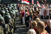 Protesters faced off against armed interior troops and riot police using their shields to block their passage