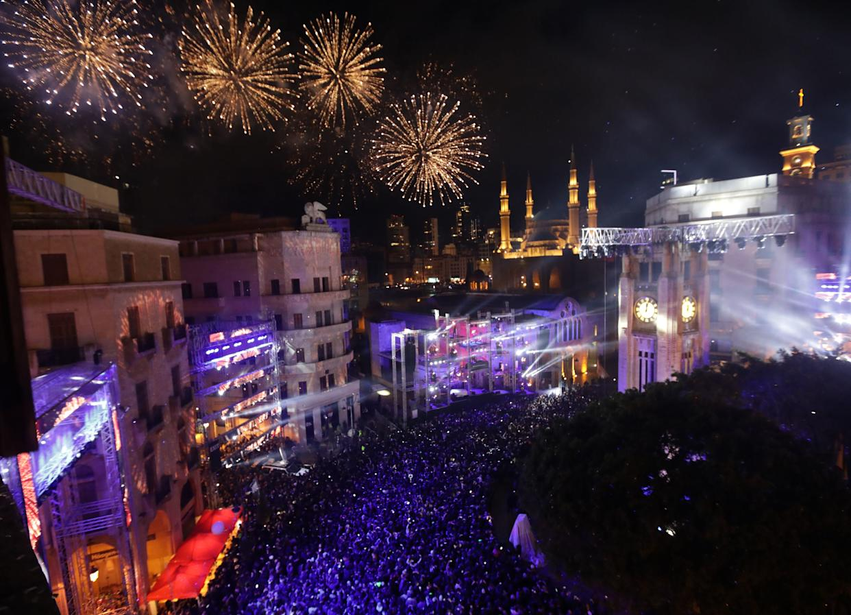 Fireworks explode over downtown Beirut, Lebanon during New Year's celebrations on January 1, 2018. (Photo: ANWAR AMRO via Getty Images)