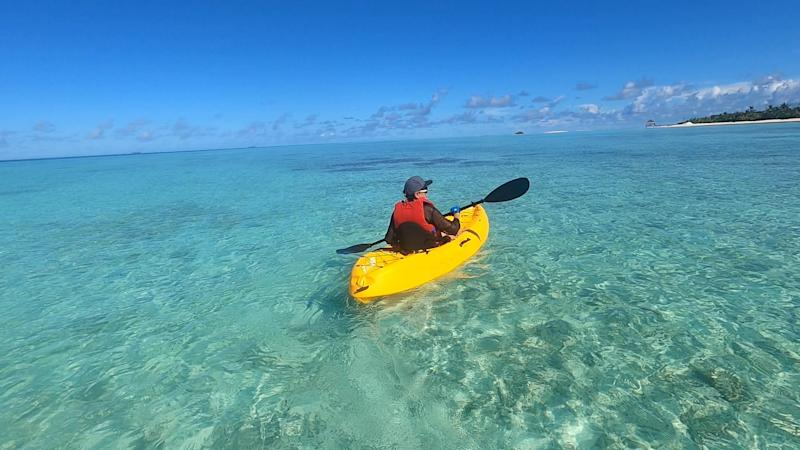 Woman canoeing at the Pullman resort in the Maldives