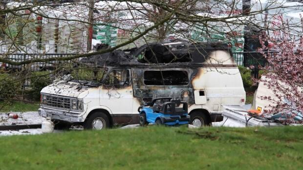 A fire in a camper van parked in East Vancouver Saturday killed a man in his 50s, and burned a 29-year-old woman, according to police. (Shane Mackichan - image credit)