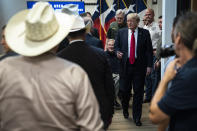 Former President Donald J. Trump and Texas Gov. Greg Abbott depart after a security briefing with state officials and law enforcement at the Weslaco Department of Public Safety DPS Headquarters before touring the US-Mexico border wall on Wednesday, June 30, 2021 in Weslaco, Texas. (Jabin Botsford/The Washington Post via AP, Pool)