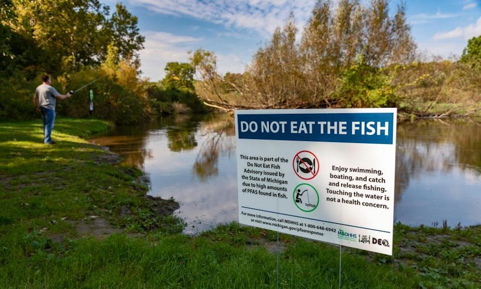 A sign at Island Lake state recreation area in Michigan warns anglers not to eat fish from the Huron River