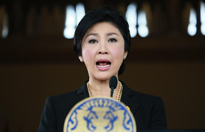 FILE - In this Nov. 28, 2013 file photo, Thai Prime Minister Yingluck Shinawatra speaks at a news conference at the government house in Bangkok, Thailand. Prime Minister Yingluck Shinawatra, sister of former Prime Minister Thaksin Shinawatra, helped set the stage for Thailand's latest protests by backing an amnesty bill that would have wiped out a corruption conviction that keeps Thaksin in self-imposed exile. Now his longtime political foes are trying to use that public anger to seize control. (AP Photo/Wason Wanichakorn, File)
