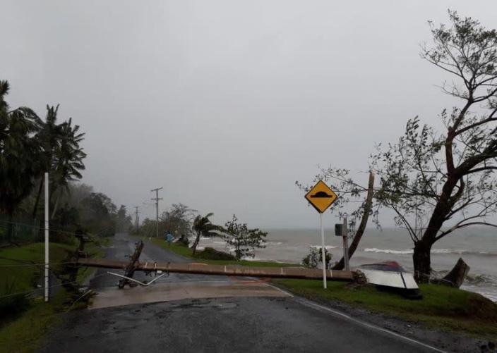 A fallen electric pole due to Cyclone Yasa lies on Lesiaceva Road in Savusavu, Fiji