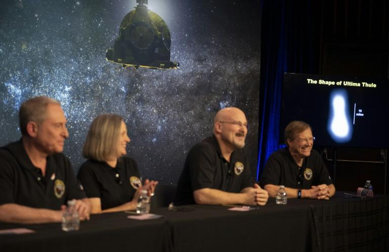 This handout photo released by NASA shows a new image of Arrokoth on a screen during a press conference after the team received confirmation from the New Horizons spacecraft that it has completed the flyby of Arrokoth (AFP Photo/NASA/Joel Kowsky)