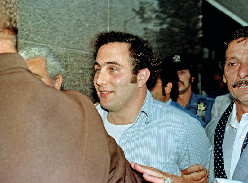 """FILE - In this August 11, 1977 file photo, David Berkowitz, center, the tabloid-loving, police-taunting """"Son of Sam"""" killer, is in the custody of police after his arrest, in New York. Thursday, Aug. 10, 2017 is the 40th anniversary of Berkowitz's capture. (AP Photo/File)"""