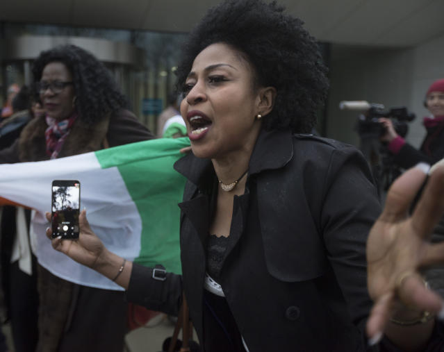Supporters of former Ivory Coast President Laurent Gbagbo celebrate outside the International Criminal Court in The Hague, Netherlands, Wednesday, Jan. 16, 2019, after judges ruled that former Ivory Coast President Laurent Gbagbo and a former government minister should be released immediately following their acquittal on charges of involvement in deadly post-election violence in 2010. (AP Photo/Peter Dejong)