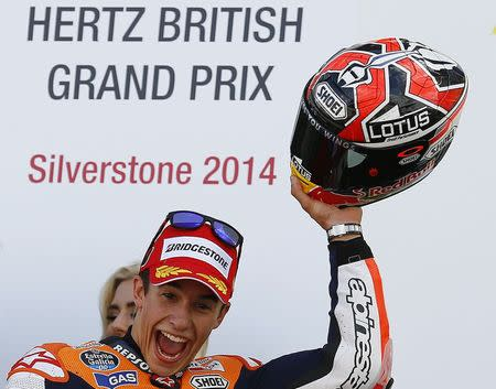Honda MotoGP rider Marc Marquez of Spain celebrates winning the British Grand Prix at the Silverstone Race Circuit