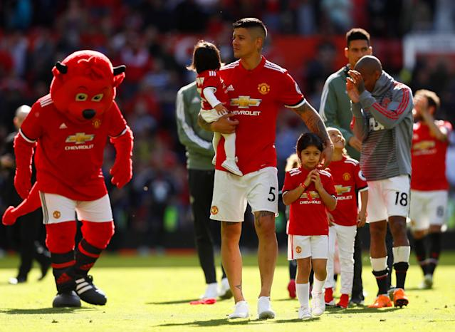 "Soccer Football - Premier League - Manchester United vs Watford - Old Trafford, Manchester, Britain - May 13, 2018 Manchester United's Marcos Rojo with his family after the match Action Images via Reuters/Jason Cairnduff EDITORIAL USE ONLY. No use with unauthorized audio, video, data, fixture lists, club/league logos or ""live"" services. Online in-match use limited to 75 images, no video emulation. No use in betting, games or single club/league/player publications. Please contact your account representative for further details."