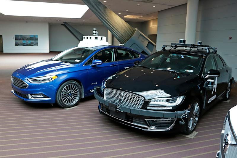 These are autonomous vehicles, a Lincoln designed and being tested in Pittsburgh by Aurora Innovations, right, and a Ford Focus designed by Argo AI, on display in Pittsburgh Monday, March 4, 2019. (AP Photo/Gene J. Puskar)