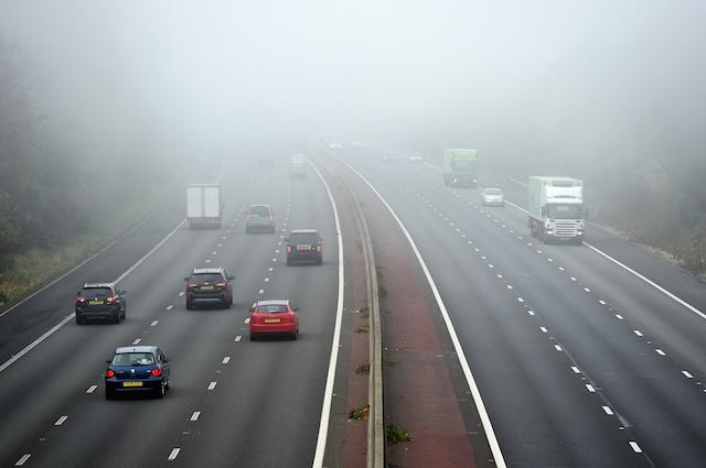 Traffic makes it's way through dense fog between junctions 5 and 6 of the M3 Motorway in Hampshire PRESS ASSOCIATION Photo. Picture date: Sunday November 1, 2015. See PA story WEATHER . Photo credit should read: Andrew Matthews/PA Wire