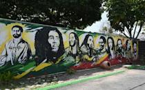 A mural depicting Ethiopian Emperor Haile Selassie I, Jamaican Reggae legend Bob Marley and his seven sons is seen on the grounds of the Bob Marley Museum in Kingston, Jamaica, on May 17, 2019