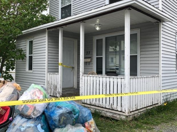 A house on Monchy Road in Grand Falls-Windsor is taped off Friday morning following a fatal shooting involving a police officer. (Anthony Germain/CBC - image credit)