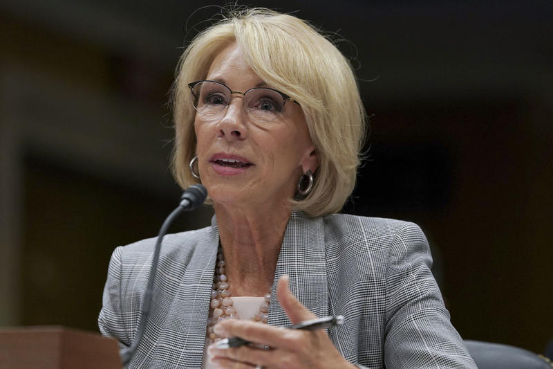 Top DeVos aide's departure prompts inquiry from Democrats