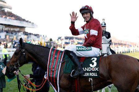 Horse Racing - Grand National Festival - Aintree Racecourse, Liverpool, Britain - April 6, 2019 Davy Russell celebrates on Tiger Roll after winning the 5.15 Randox Health Grand National Handicap Chase Action Images via Reuters/Paul Childs