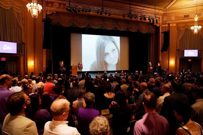 Mourners gather inside the Paramount Theater.