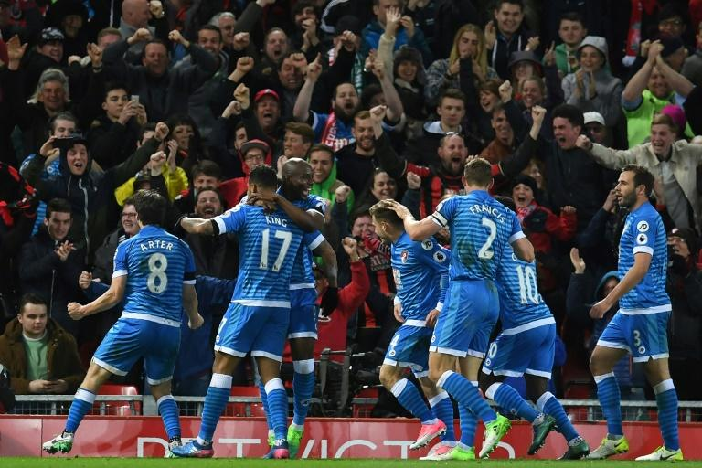 Bournemouth's striker Joshua King (2nd L) celebrates with teammates after scoring their second goal during the English Premier League football match between Liverpool and Bournemouth at Anfield in Liverpool, north west England on April 5, 2017