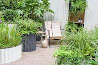 """<p>Inspired by life at the beach, the Hot Tin Roof Container Garden includes coastal landscaping, <a href=""""https://www.countryliving.com/uk/homes-interiors/gardens/a37444021/country-living-flower-bulbs-homebase/"""" rel=""""nofollow noopener"""" target=""""_blank"""" data-ylk=""""slk:plants"""" class=""""link rapid-noclick-resp"""">plants</a> that offer shade, bright blue tiles under the outdoor shower, and undulating corrugated steel planters to tie the whole look together. Bringing the beach to your garden just got easier...</p>"""