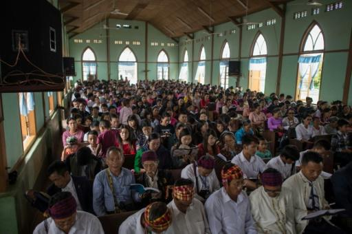 Internally displaced people and local villagers attend a church service in Myitkyina, Kachin state. Ethnic Kachin are mainly Christians in a nation that is overwhelmingly Buddhist