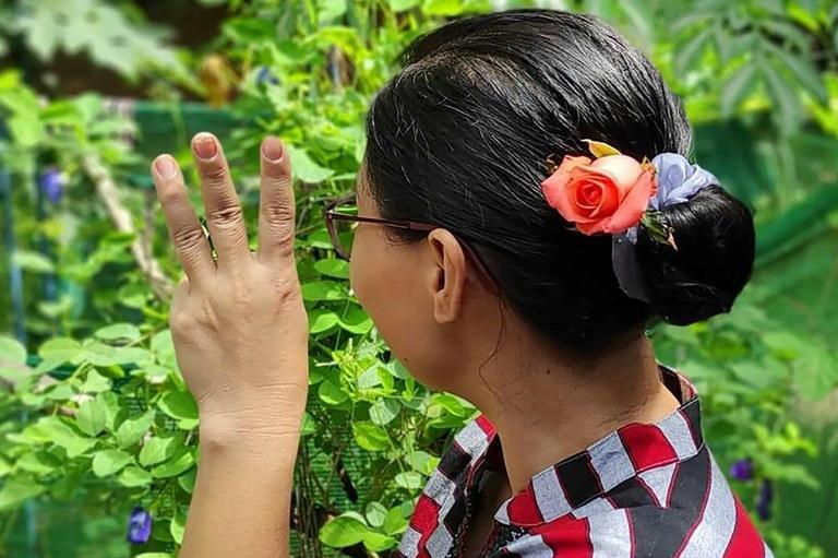 Flowers tucked into a bun have long been a signature look of Myanmar's ousted leader Aung San Suu Kyi