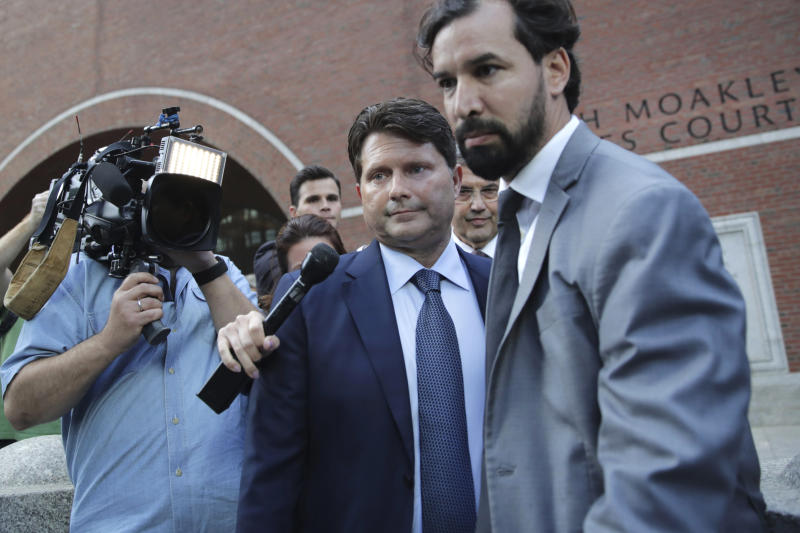 Devin Sloane, center, departs federal court after sentencing in a nationwide college admissions bribery scandal in Boston, Tuesday, Sept. 24, 2019. Sloane admitted to paying $250,000 to get his son into the University of Southern California as a fake athlete. (AP Photo/Charles Krupa)